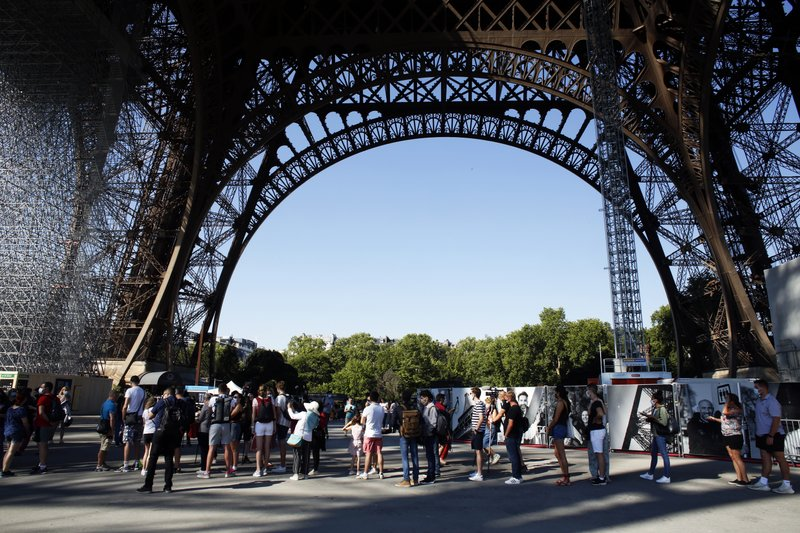 Eiffel Tower reopens, ending 104-day coronavirus shutdown