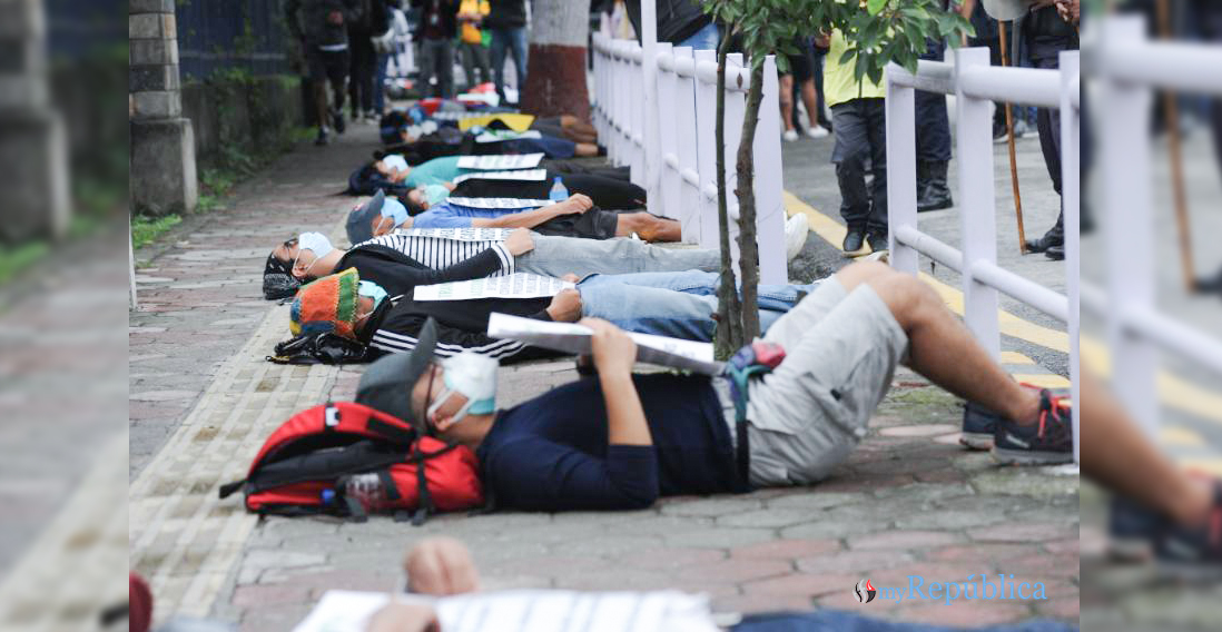 PHOTOS: Youths lie down on ground to protest against 'lies' in capital