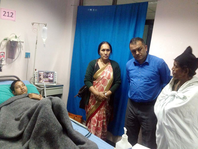 Health Minister Thapa visits burn-injured Raute youth (with video)