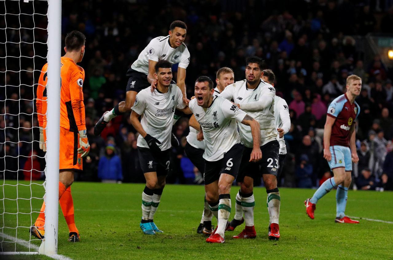 Klavan gives Liverpool last-gasp victory, United beat Everton