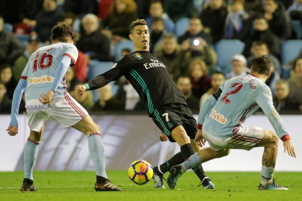 Real fall 16 points behind Barca after draw with Celta