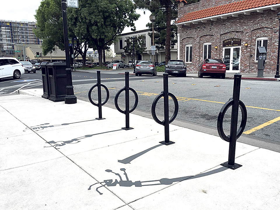 Street Artist Painting Fake Shadows in Redwood City