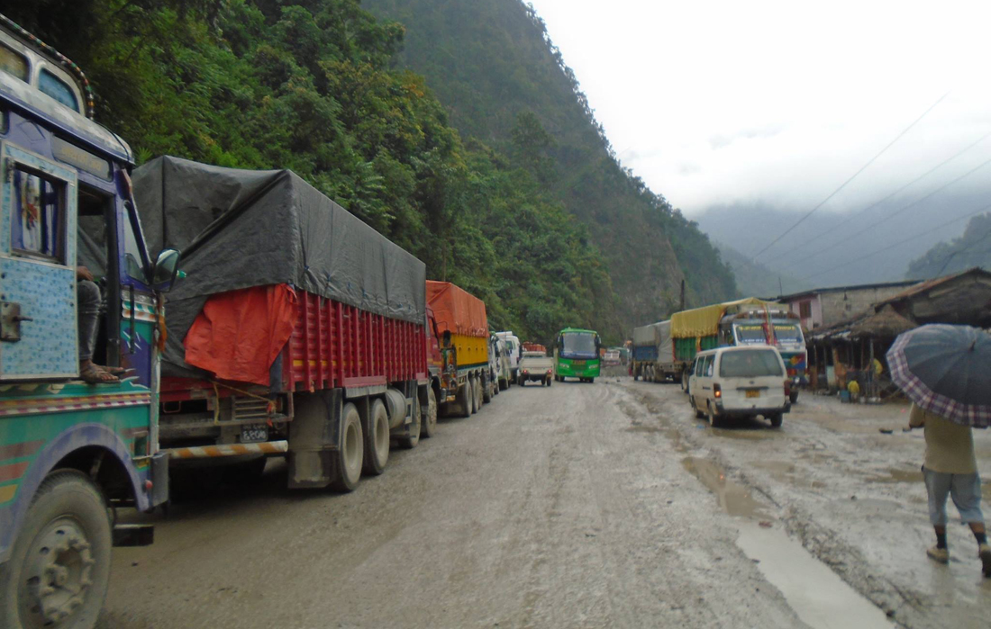 Vehicles stranded for hours due to delay in clearing landslide debris