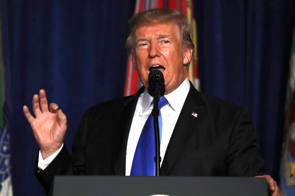 Trump commits US to fight on in Afghanistan ; no speedy exit
