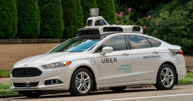 Uber suspends self-driving car tests after woman dies in Arizona