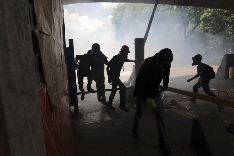 Venezuelans again take to streets as death toll jumps to 37