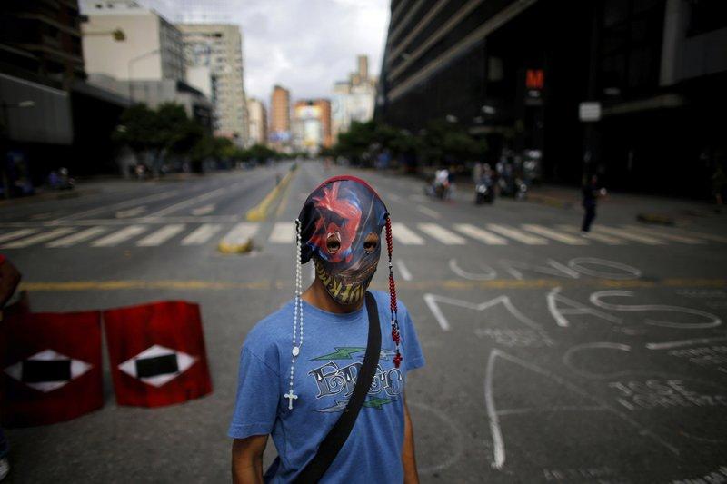 Venezuela leader's foes levy new sanctions and fresh strike