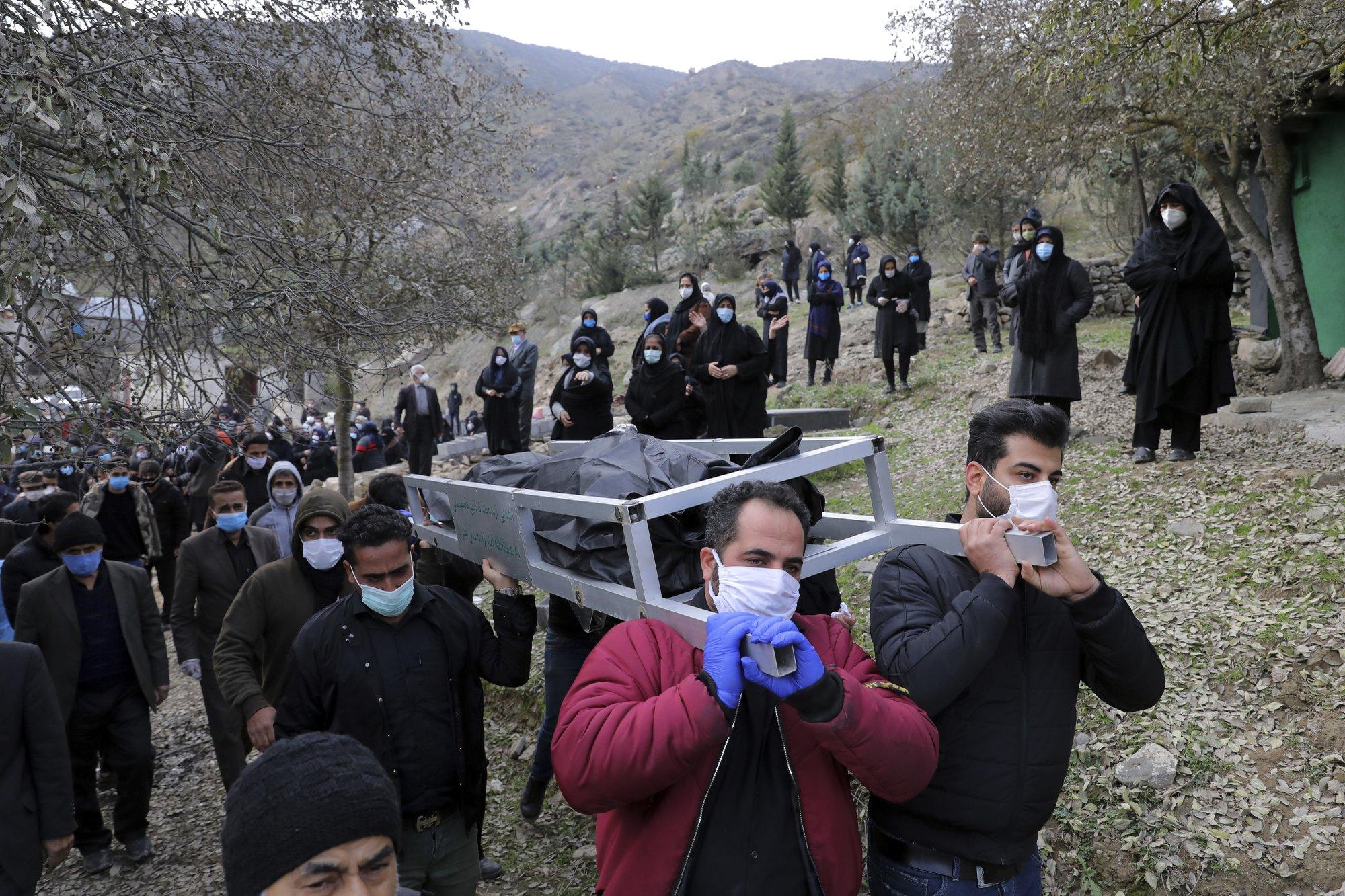 Far from the capital, Iran struggles to bury virus victims