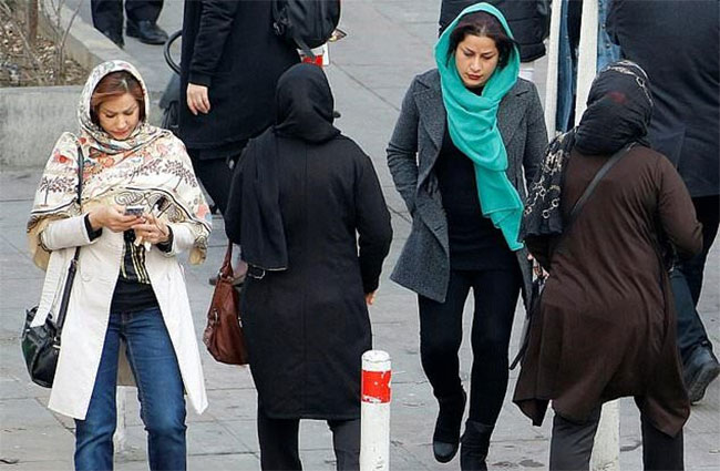 Woman is jailed for two years for taking off her obligatory Islamic headscarf in Iran
