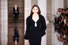 Victoria Beckham's black dresses, chunky platform boots stage 'gentle rebellion' at London Fashion Week